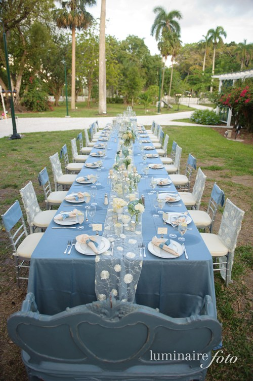 vintage wedding reception family long table seating blue mason jars edison ford